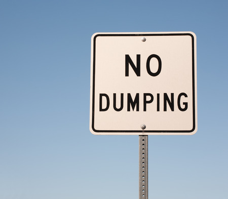 dumping: No dumping sign and blue sky