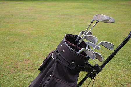 chrome man: Detail view of golf clubs in bag with sky background