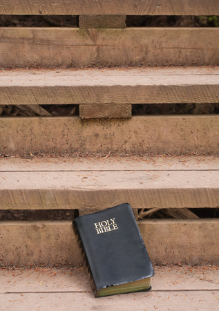 Holy Bible on outdoor wooden stairs. photo