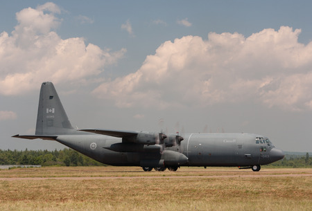 lockheed martin: DEBERT, CANADA - JULY 7, 2013: Royal Canadian Air Force C-130 Hercules. The  C-130 Hercules is a four engine turbine military aircraft built by Lockheed which is now Lockheed Martin. The C-130 has been in service since the 1950s.