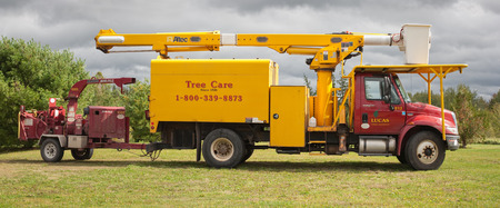 service tree: Pleasant VALLEY, CANADA - SEPT 22, 2014: Lucas Tree Experts is a utility tree Service company headquartered in Portland, ME. The company provides services for utilities, Electric, Pipelines, Municipalities and DOT. Editorial