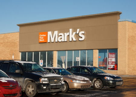 retailer: TRURO, CANADA - DECEMBER 11, 2013: Marks Work Wearhouse is a  clothing retailer in Canada. Canadian Tire has owned Marks since 2001.