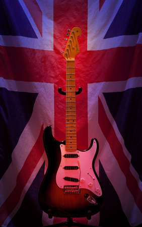 Pleasant Valley, Canada - March 19, 2013: Fender Stratocaster and Unioun Jack. The Fender Stratocaster is an electric guitar designed by Leo Fender, George Fullerton, Bill Carson and Freddie Tavares. The Stratocaster has been made by The Fender Musical In Editorial