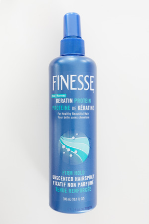 finesse: PLEASANT VALLEY, CANADA - FEBRUARY 25, 2015: Finesse Hairspray bottle. Lornamead, Inc. markets and sells more than 35 personal care brands including Finesse Hairspray. Editorial