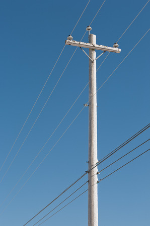 electric grid: Wooden power pole and lines during Winter. Stock Photo