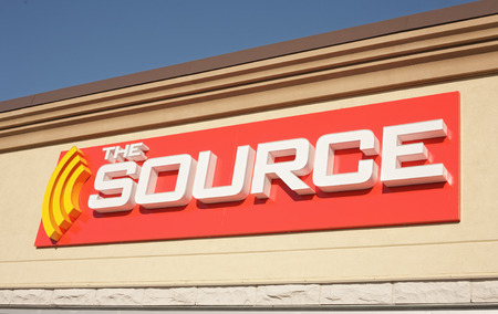 specializes: ELMSDALE, CANADA - APRIL 01, 2015: The Source retail outlet. The Source, previously Radioshack and The Source by Circuit City, is a retailer which specializes in electronics and has more than 700 outlets in Canada