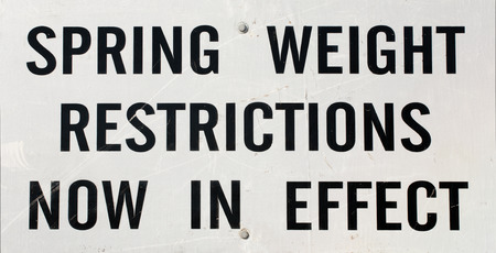 Closeup view of Spring weight restriction highway sign