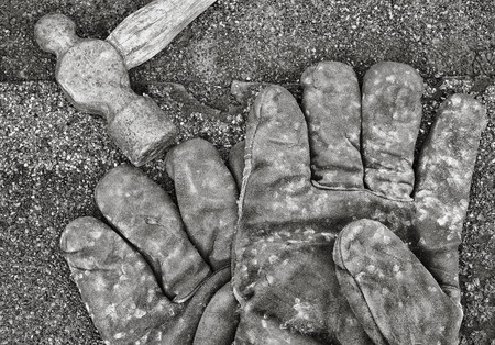 peen: Work gloves and old ball-peen hammer on shingles. Black and white image.