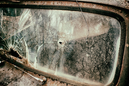 junked: Broken windshield detail on an old decayed vehicle. Grunge look. Stock Photo