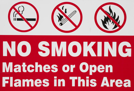No smoking matches or or open flames  warning sign.
