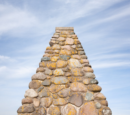 pyramidal: Pyramidal shaped stone monument and sky with copy space. Stock Photo