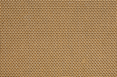weaved: Weaved grill fabric. Warm golden color. Stock Photo