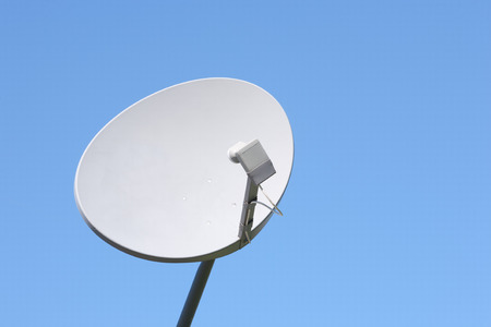 Wireless satellite dish with blue sky copy space.