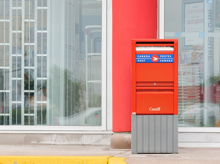 post mail: TRURO, CANADA - JULY 21, 2015: Canada Post Corporation Socit canadienne des postes is Canadas main postal service provider. Canada Post is a crown corporation.