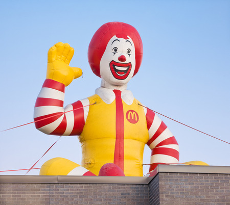 mcdonald: DARTMOUTH, CANADA - AUGUST 02, 2015: Ronald McDonald inflatable on rooftop. Ronald McDonald is a clown character and is the primary mascot of McDonalds restaurant chain.