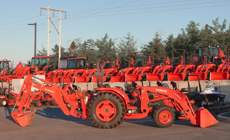 heavy industry: DARTMOUTH, CANADA - AUGUST 02, 2015: Kubota tractors display. Kubota Corporation is a Japanese heavy equipment manufacturer with an array of products such as tractors and agricultural equipment. Editorial
