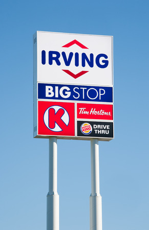 enfield: ENFIELD, CANADA - AUGUST 07, 2015: Irving Oil And Big Stop Sign. Irving Oil Ltd. is an energy producing and exporting company, including gasoline, oil, and natural gas. Editorial