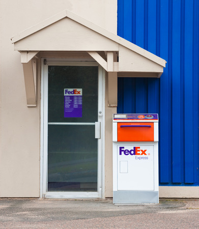 drop off: TRURO, CANADA - AUGUST 09, 2015: FedEx drop off delivery box. FedEx Corporation is an American courier company based in Memphis, Tennessee and operates on a global scale.
