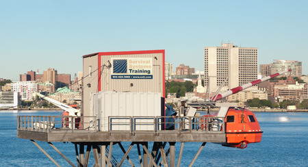 DARTMOUTH, CANADA - AUGUST 07, 2015: Survival Systems Training platform. Survival Systems Limited provides in aircraft over-water ditching simulation, personnel-rated lifting systems and safety training.