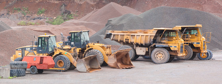 heavy industry: WENTWORTH, CANADA - AUGUST 23, 2015: Caterpillar 769C Off-Highway trucks and 972G Wheel Loaders at Lafarge facility.