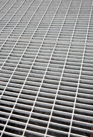 grate: Gray metal grate detail.