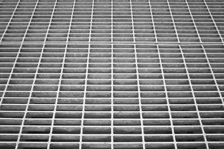 metal grate: Metal grate detail. Black and white image. Stock Photo