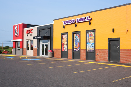 STEWIACKE, CANADA - AUGUST 29, 2015: Taco Bell is a fast food restaurant chain based in California. KFC or Kentucky Fried Chicken is a fast food restaurant chain specializing in fried chicken. KFC is based in Kentucky. Editöryel