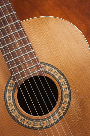 nylon string: Nylon string acoustic guitar detail. Stock Photo
