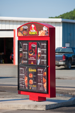 drive through: Kennetcook, Canada - September 16 2015: Robins Donuts drive through menu sign. Robins Donuts is a donught retaurant chain with more than 130 outlets operating Canada wide.