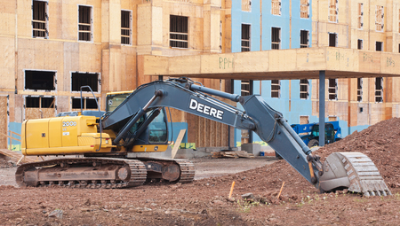 john deere: TRURO, CANADA - SEPTEMBER 20, 2015:  John Deere excavator on construction site. John Deere is an American company manufacturing heavy industrial and lawn care equipment. Editorial
