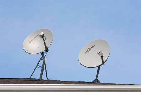 PLEASANT VALLEY, CANADA - SEPTEMBER 22, 2015: Shaw Direct and Xplornet satellite dishes. Shaw Direct is a Canadian satellite television broadcaster. Xplornet Communications is a Canadian rural internet service provider.