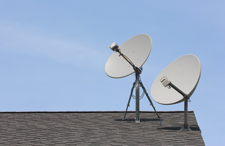 Two wireless dishes on rooftop