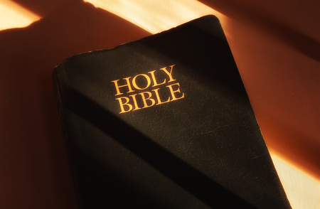 Holy Bible in sunlight with glow effect. Stock Photo