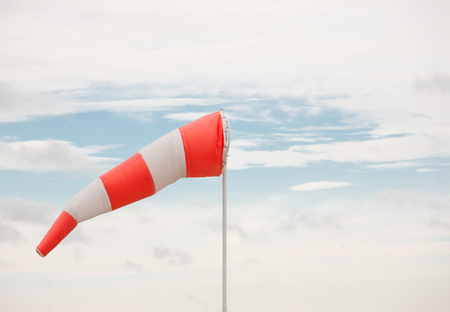 wind instrument: Airport windsock and sky