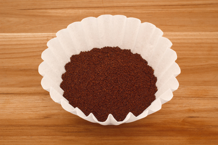 percolate: Coffee grounds in filter. Stock Photo