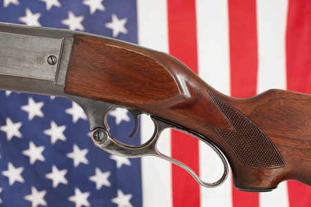 Rifle detail with American flag background
