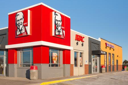 STEWIACKE, CANADA - JANUARY 16, 2017: KFC or Kentucky Fried Chicken is a fast food restaurant chain specializing in fried chicken. KFC is based in Kentucky. Taco Bell is a fast food restaurant chain based in California.