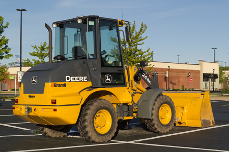 brandt: DARTMOUTH, CANADA - JUNE 10, 2017: John Deere compact wheel loader. John Deere is an American company manufacturing heavy industrial and lawn care equipment.