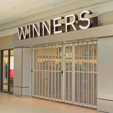 merged: TRURO, CANADA - JULY 05, 2017: Winners store. Winners is a Canadian department store chain offering clothing, bedding, jewellery, beauty items, furniture and housewares. Winners merged with TJX in 1990
