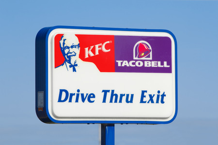 STEWIACKE, CANADA - MAY 8, 2018: KFC or Kentucky Fried Chicken and Taco Bell fast food restaurant icon.
