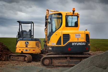 BROOKFIELD, CANADA - JUNE 9, 2018: Hyundai and John Deere excavators. Hyundai is a manufacturer of Hydraulic crawlers and wheeled excavators. John Deere is a manufacturer of heavy equipment, various machinery and lawn care equipment.