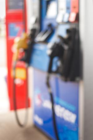 Gas station pumps blur.