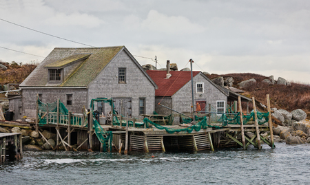 Traditional wooden fishing shacks at Peggys Cove, Nova Scotia. Stock Photo