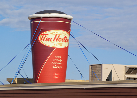STEWIACKE, CANADA - JUNE 22, 2017: Tim Hortons display. Tim Hortons is a Canadian restaurant chain known for its coffee and doughnuts. In 2014 Burger King purchased Tim Hortons for 11.4 billion $US. Editorial