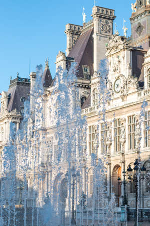 bilding: a water fountain in frond of a building in france