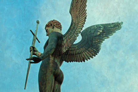 statues: Male Angel Archangel Statue holding a sword Stock Photo