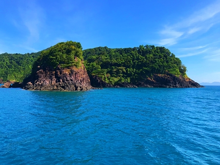 Sail through a beautiful green island with cloud and blue sea for snorkeling at Koh Chang, Thailand