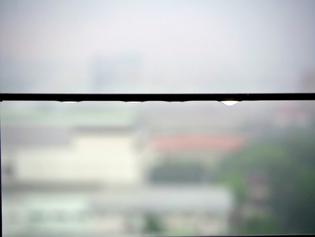 The heavy rain in the background cause the rain drop on the steel fence corridor 版權商用圖片
