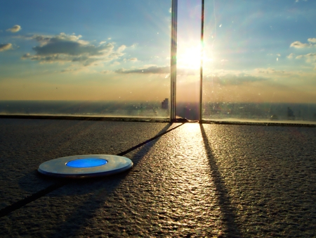 Led light plate on the floor at the roof top with evening sun, Bangkok, Thailand 版權商用圖片
