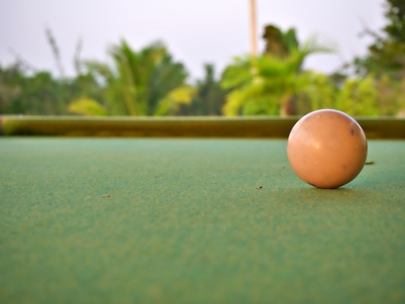 Wide landscape on the used white billiard ball on the pool with blur background